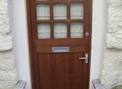 A flood proof door that maintains the existing aesthetic of a historic building